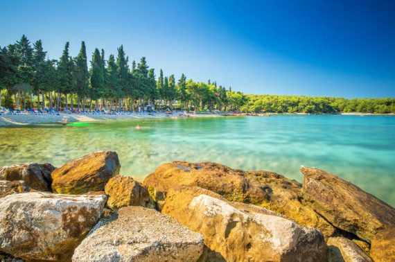 Beach in Supetar town on Brac island with turquoise clear water, Supetar, Brac, Croatia, Europe.